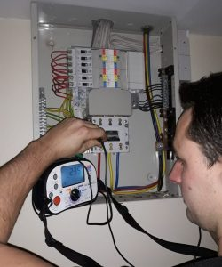 Periodic inspection on a consumer unit, Periodic inspection on a consumer unit being carried out by one of our electricians